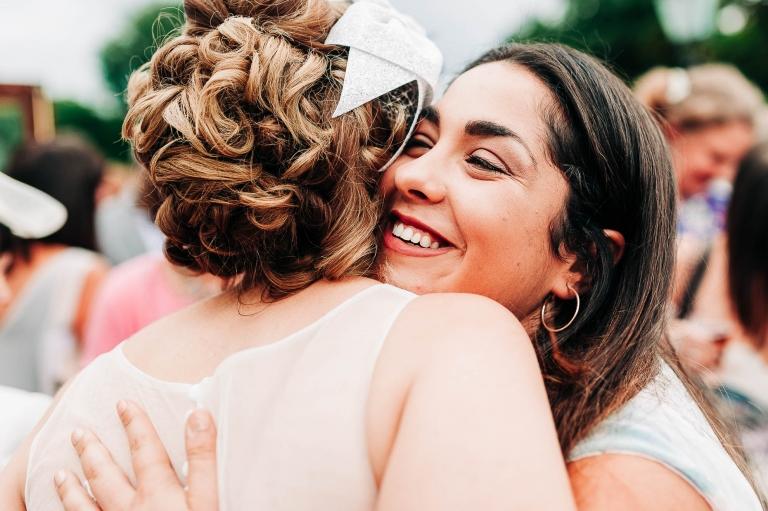 Guest hugs the bride