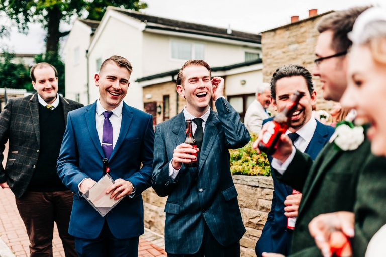 Wedding guests share a joke with the happy couple