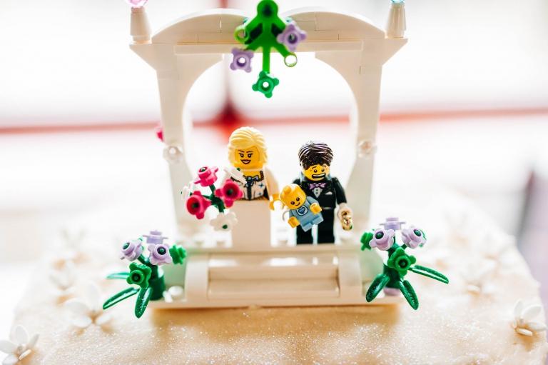 Lego figures on top of wedding cake