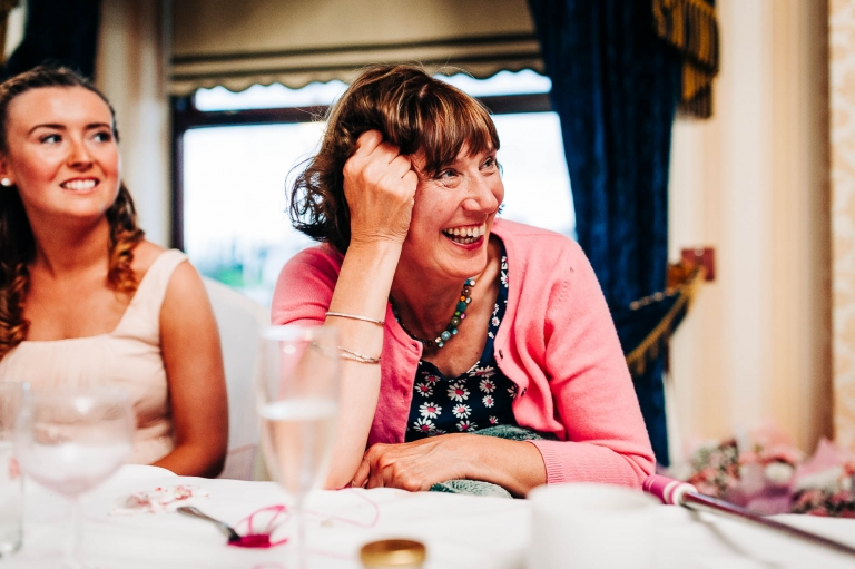 Mother of the bride laughs during the speeches