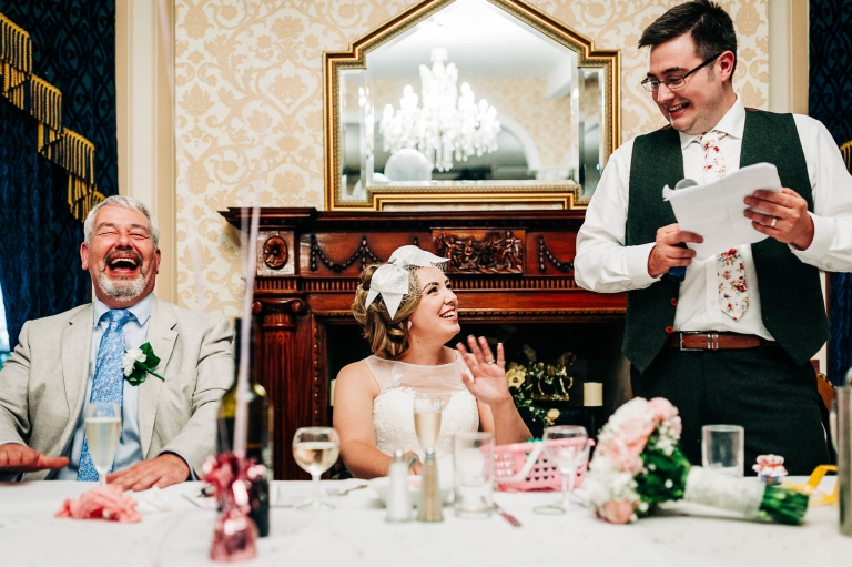 Father of the Bride laughs during the speeches