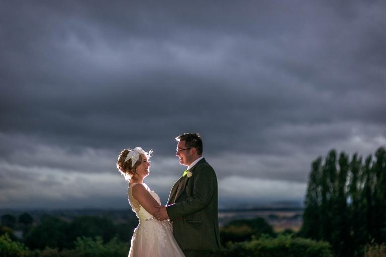 Bride and groom backlit flash portrait