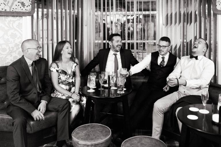 Wedding guests share a joke