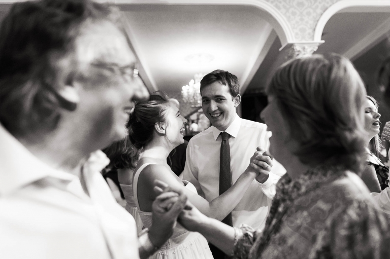 Bridesmaid and partner dancing