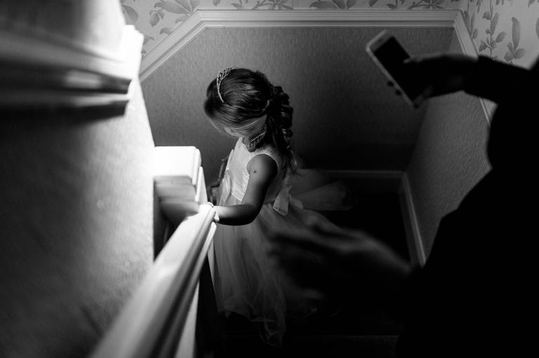 flower girl walks down stairs