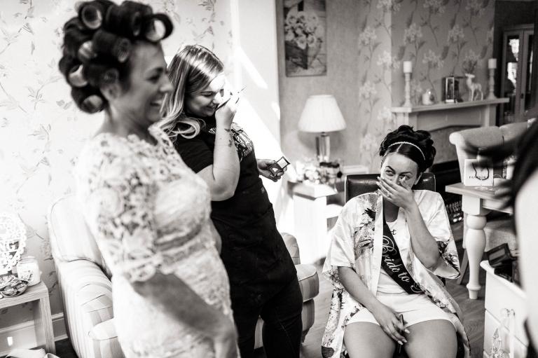 bride and mum share a joke