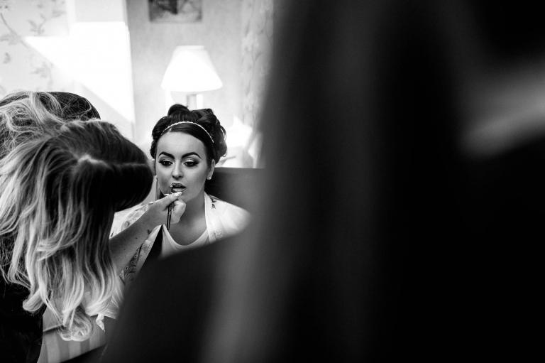 bride has lipstick applied