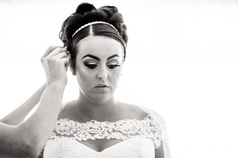 bride has hair adjusted
