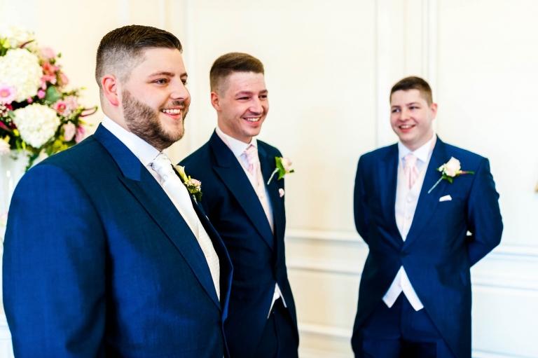 groom and ushers share a joke
