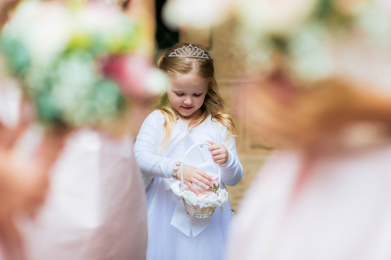 flower girl is very pleased with her flower petals