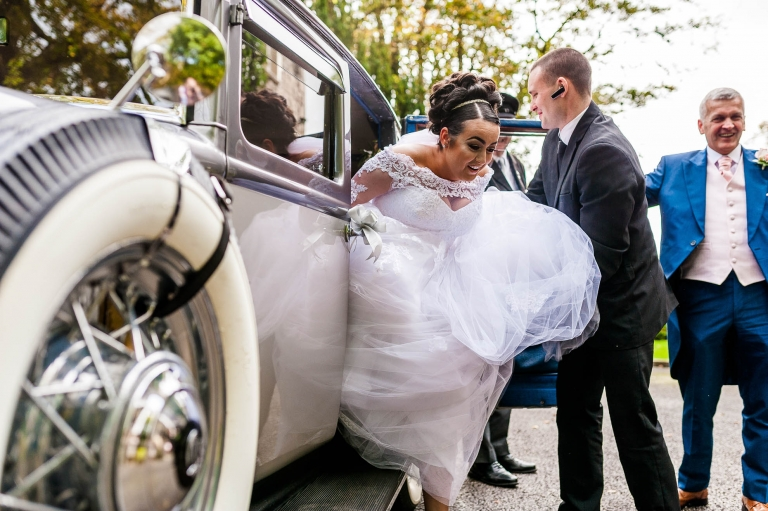 bride exits the wedding car