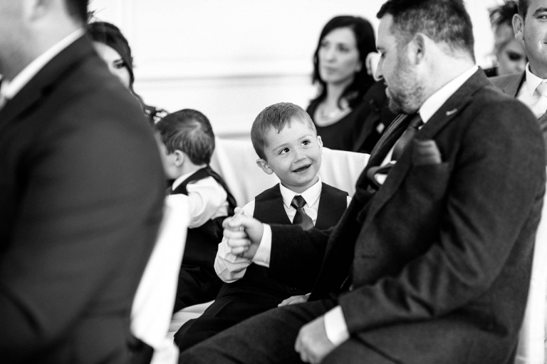 little boy shares a joke with his father