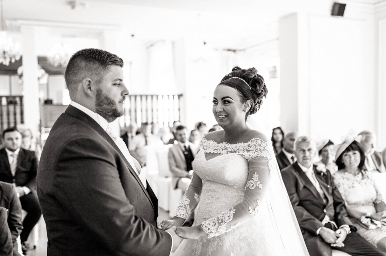 bride and groom laugh during exchange of vows