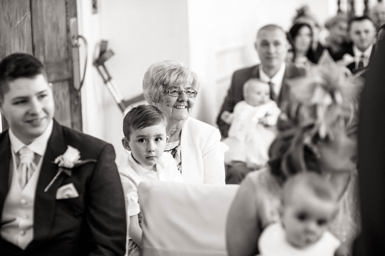 grandmother smiles during the ceremony