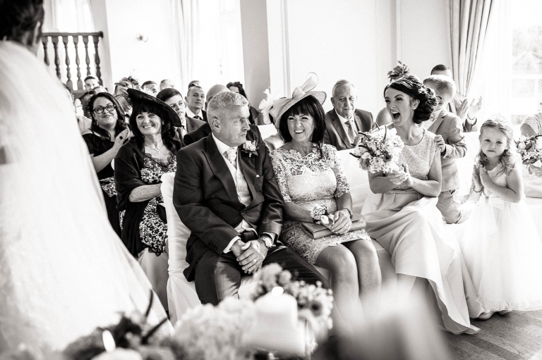 brides family cheer as they are announced husband and wife