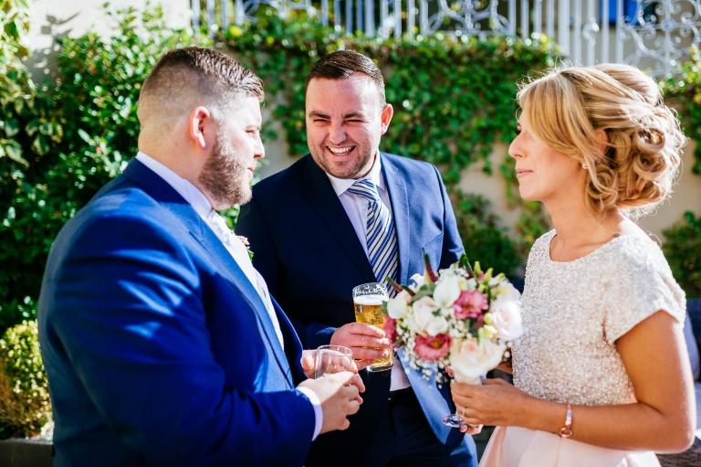 guest congratulates groom