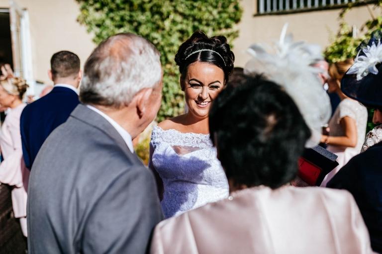 guests congratulate bride