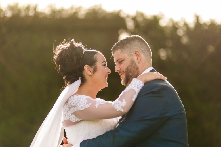 bride and groom hold each other