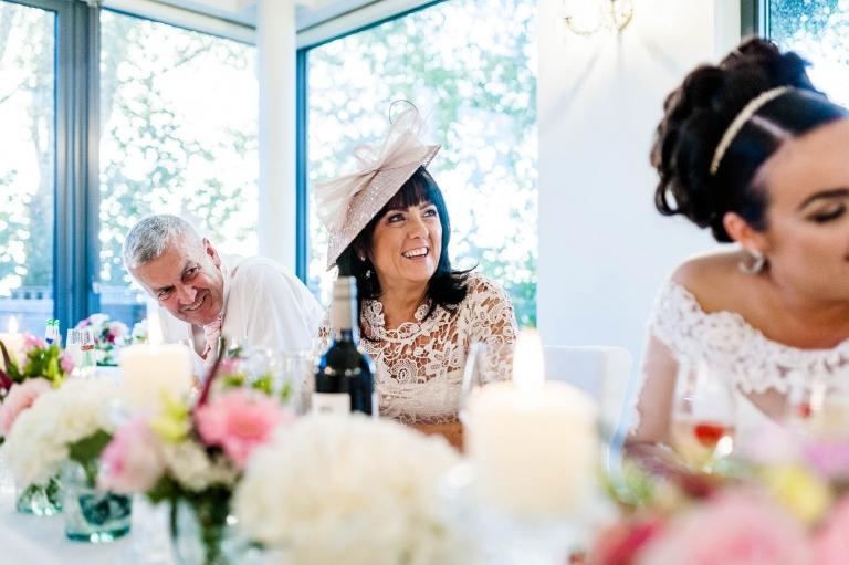 brides mum laughs at grooms joke
