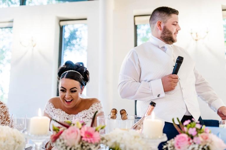 bride laughs at groom's joke