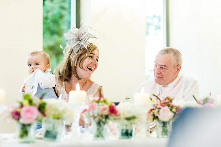 groom's parents laugh