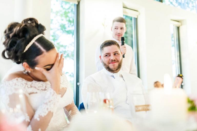 bride laughs at best man's speech