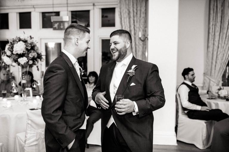 groom and best man share a joke