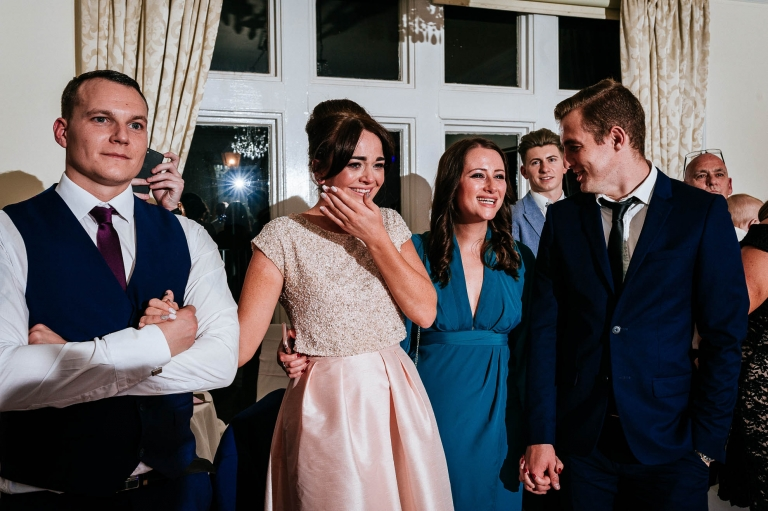 bridesmaid sheds a tear during first dance