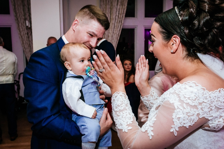 bride plays with baby son