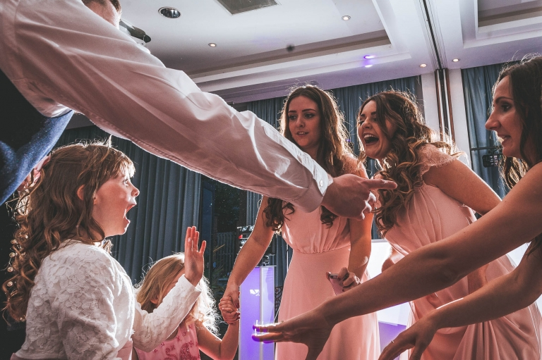 Flower girl and bridesmaids dance during the first dance