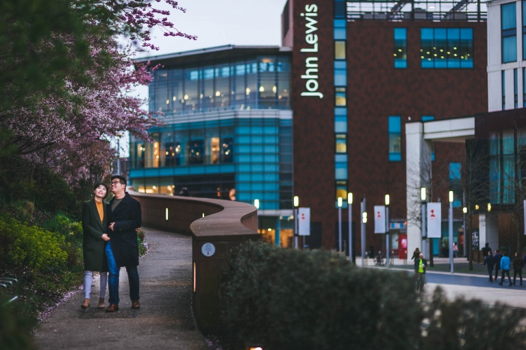 Engaged couple walking through Liverpool One