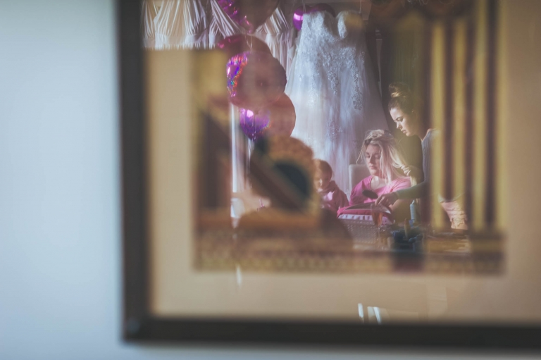 reflection of bridesmaid in mirror