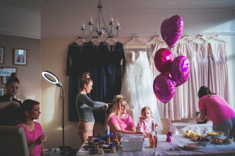 bridesmaids getting ready during bridal preparations