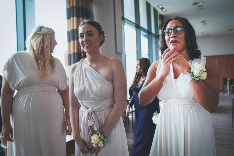 bridesmaids get emotional as bride arrives