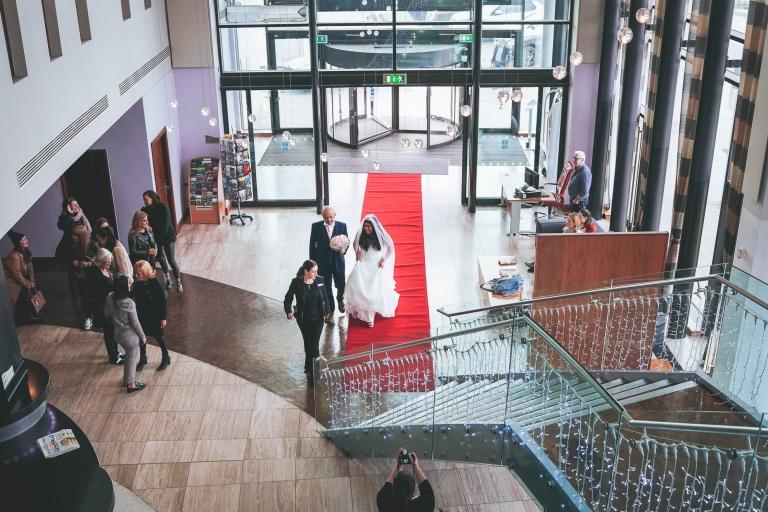 bride enters Liverpool Hilton Foyer