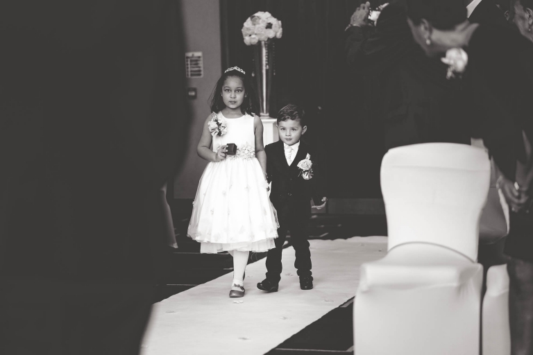 flower girl and page boy walk up aisle