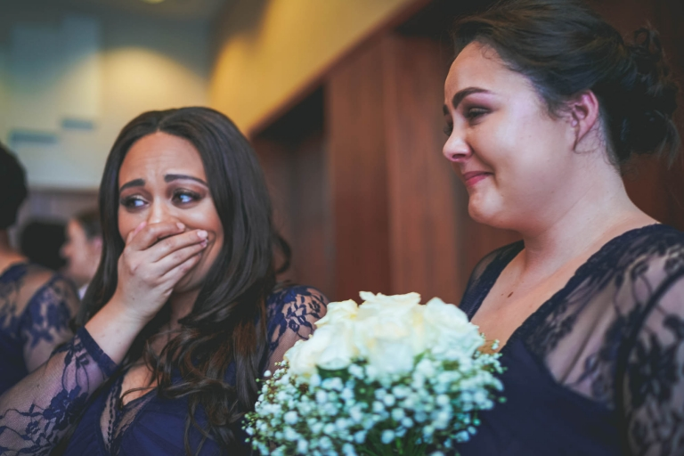 brides sister cries as bride walks up aisle