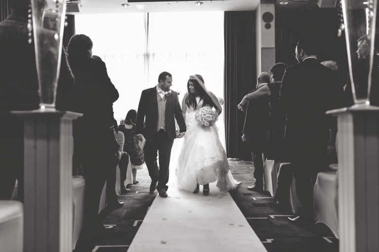 bride and groom walk back down the aisle
