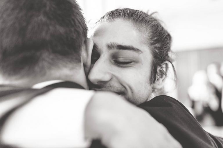 best man hugs groom