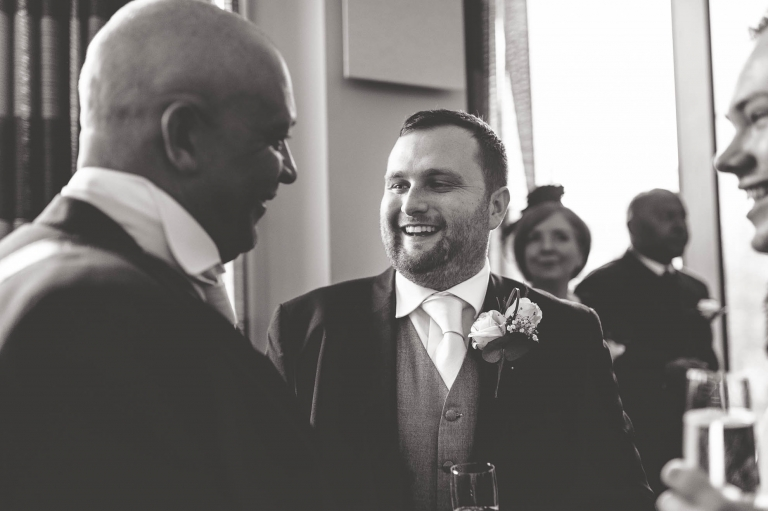 groom shares a joke with father of the bride