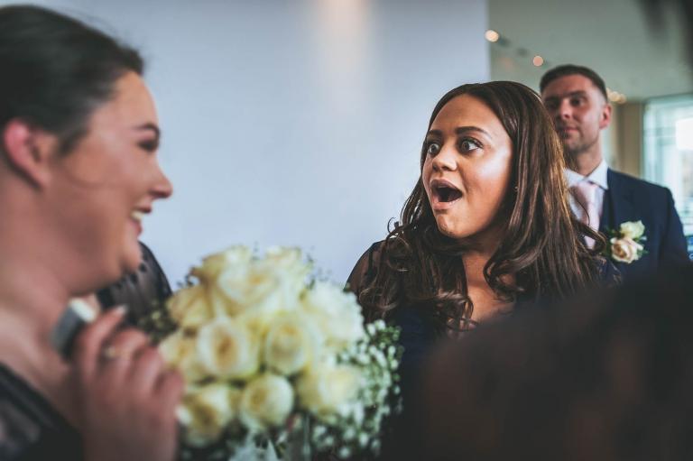 bridesmaids share joke
