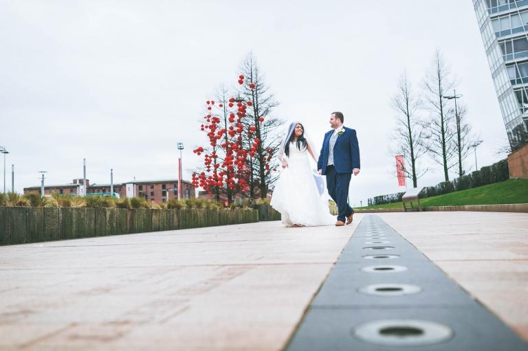 bride and groom share a joke