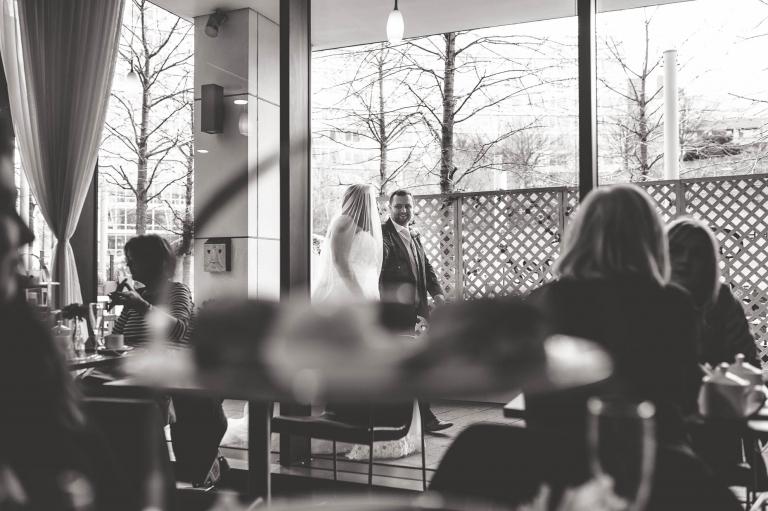 bride and groom shot through a window