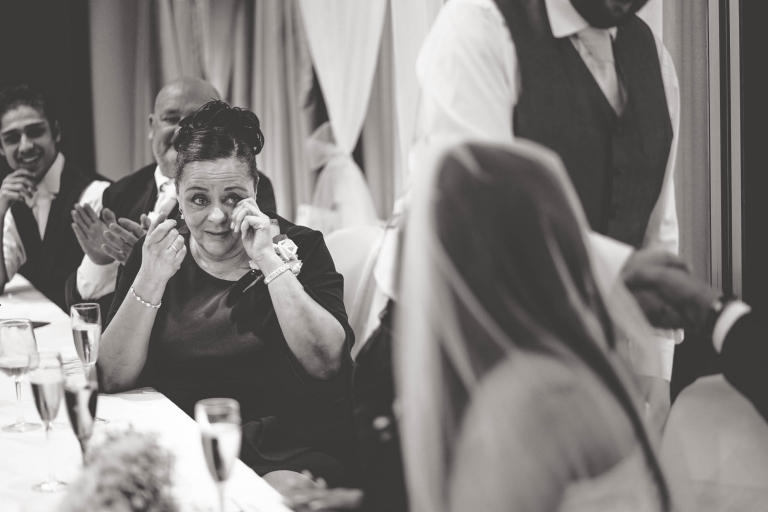 mother of the bride sheds a tear