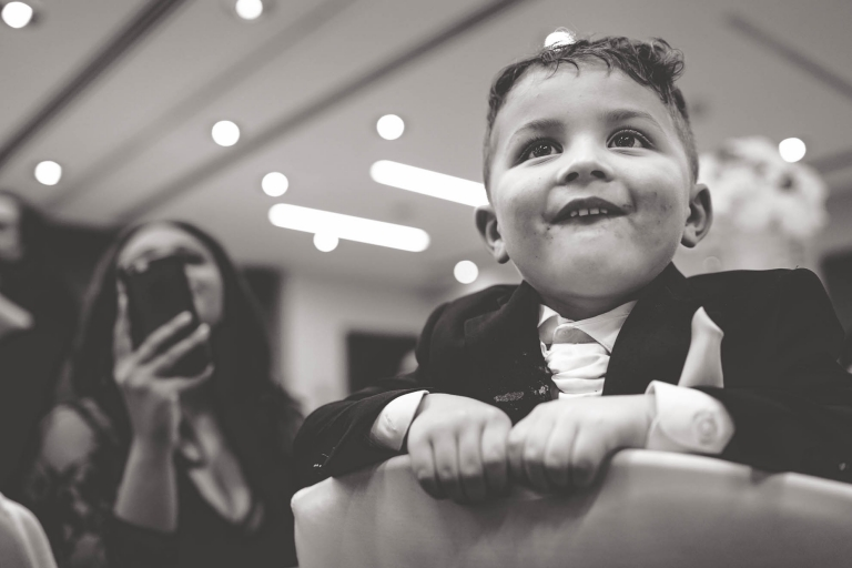 page boy laughs at speeches