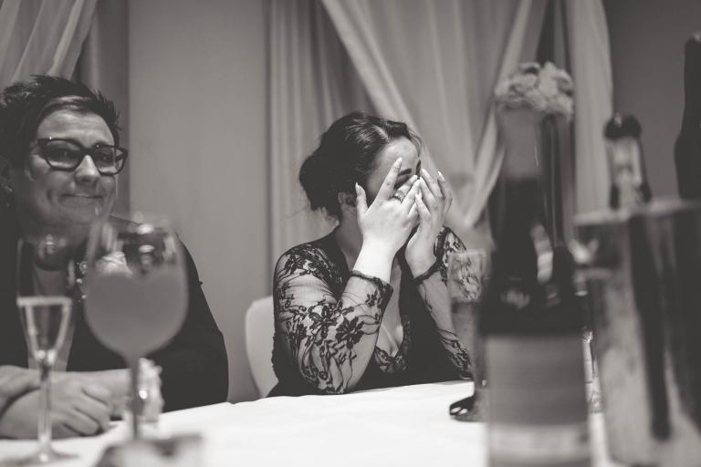 bridesmaid wipes away a tear