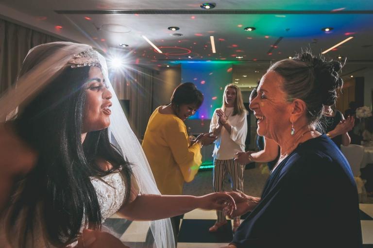bride dances with her grandmother