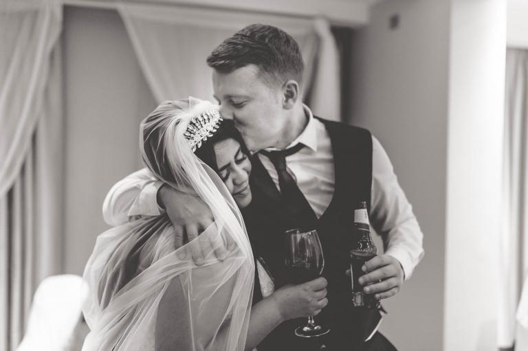 guest kisses bride