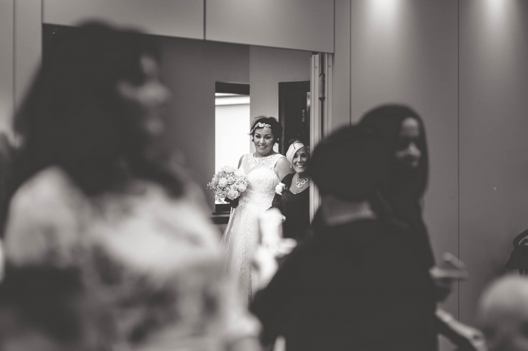 bride waiting to walk up ails