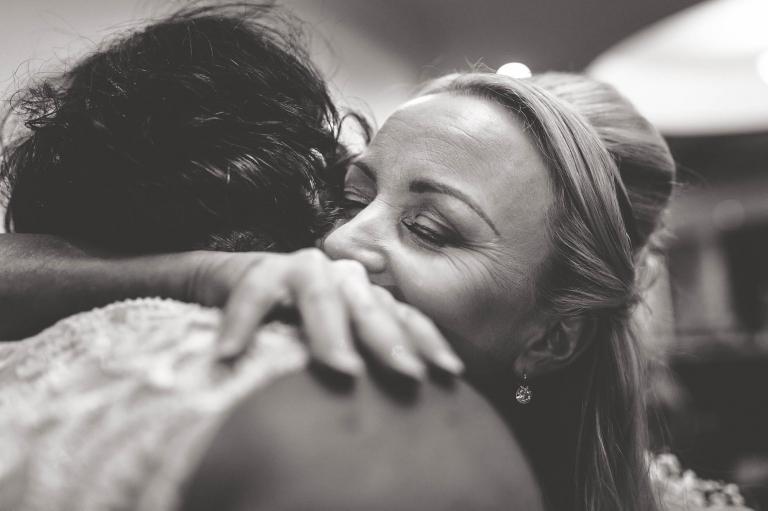 bride hugs partner